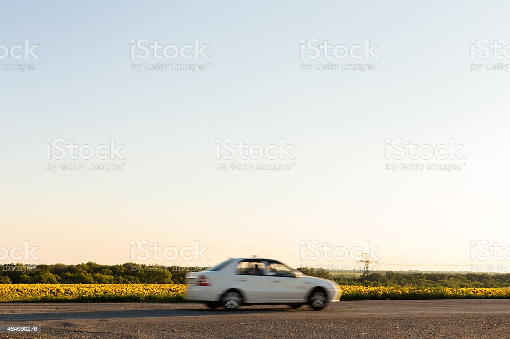 Blurred car next to field stock photo