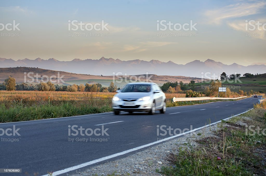Blurred car traveling on road royalty-free stock photo