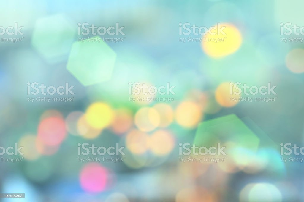 Blurred city lights background with green bokeh flares stock photo