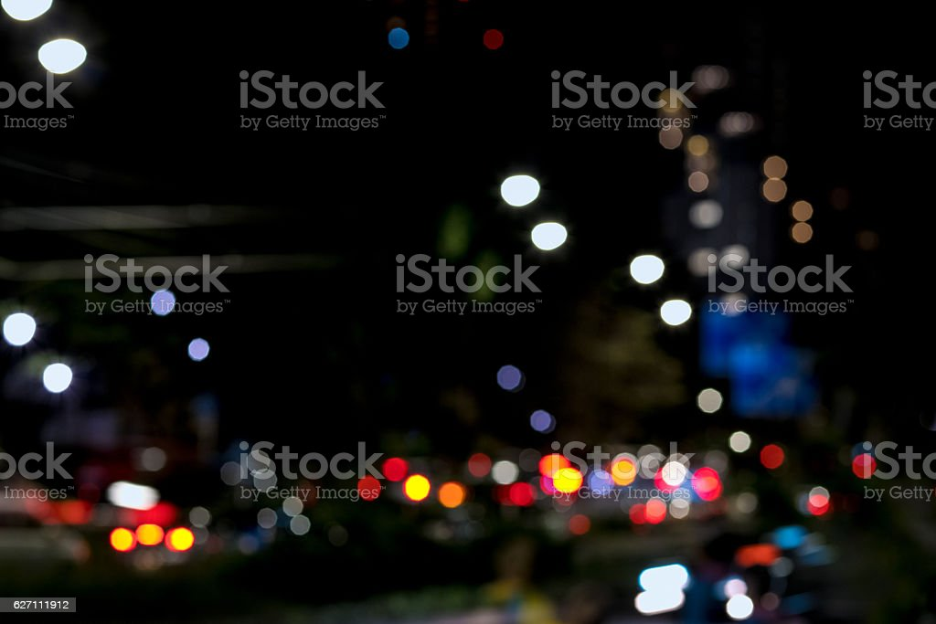 blurred city lights in the night stock photo