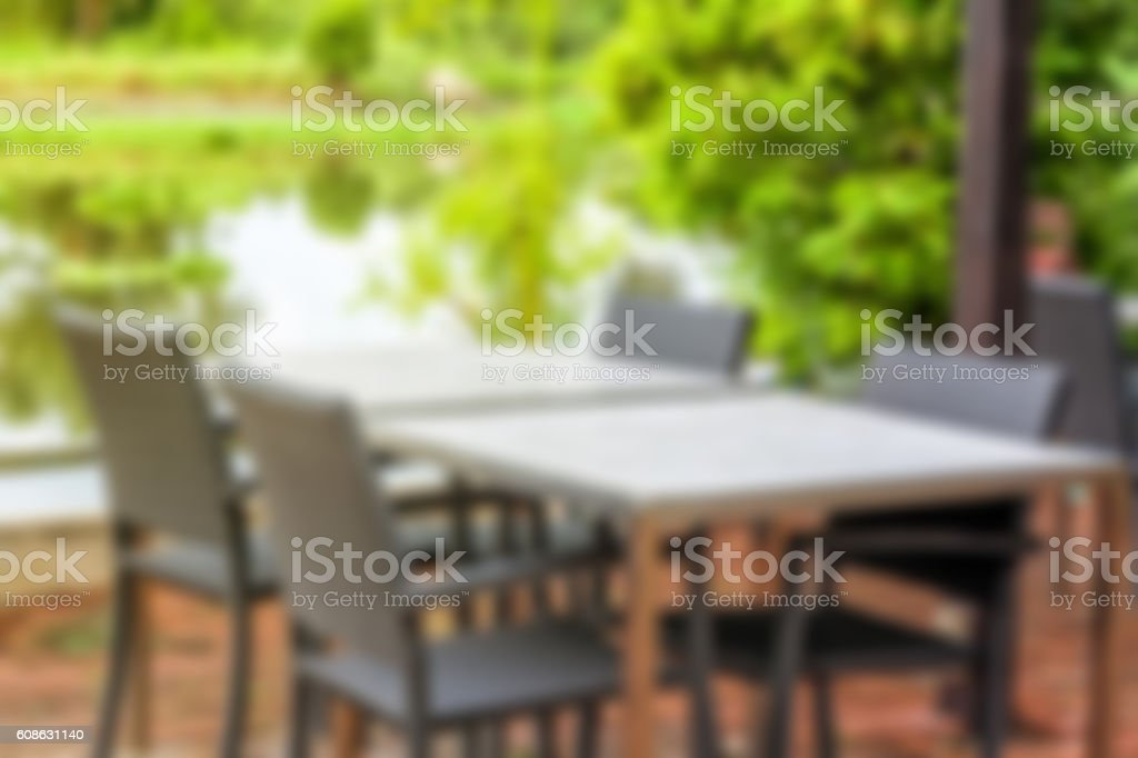 Blurred classic table with four chairs beside the beautiful river stock photo