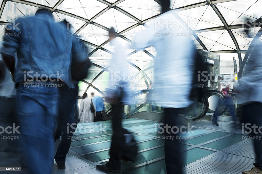 Blurred Commuters Entering and Exiting Entrance to Subway Station royalty-free stock photo
