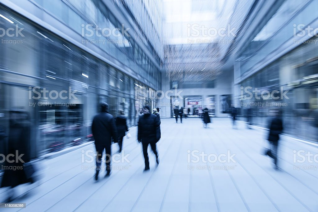 Blurred commuters in motion at the mall royalty-free stock photo