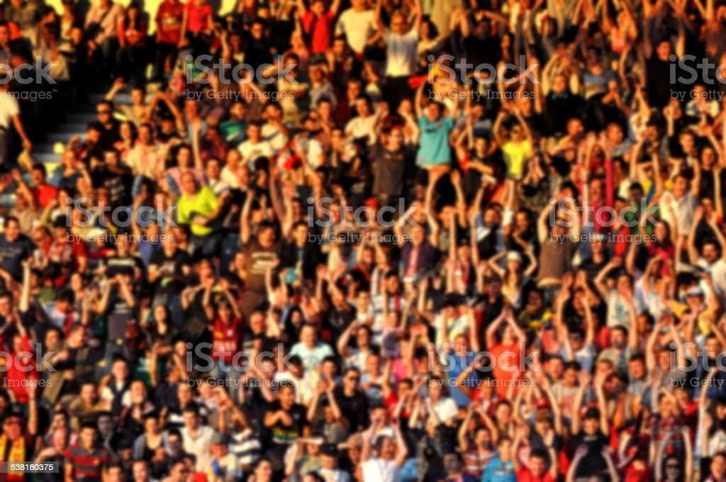 Blurred crowd of people in a stadium stock photo