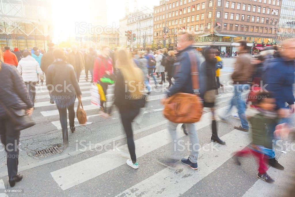 Blurred crowd of people walking on zebra crossing in Copenhagen stock photo