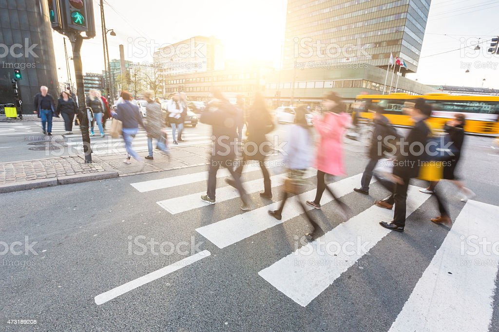 Blurred crowd of people walking on zebra crossing in Copenhagen stock photo