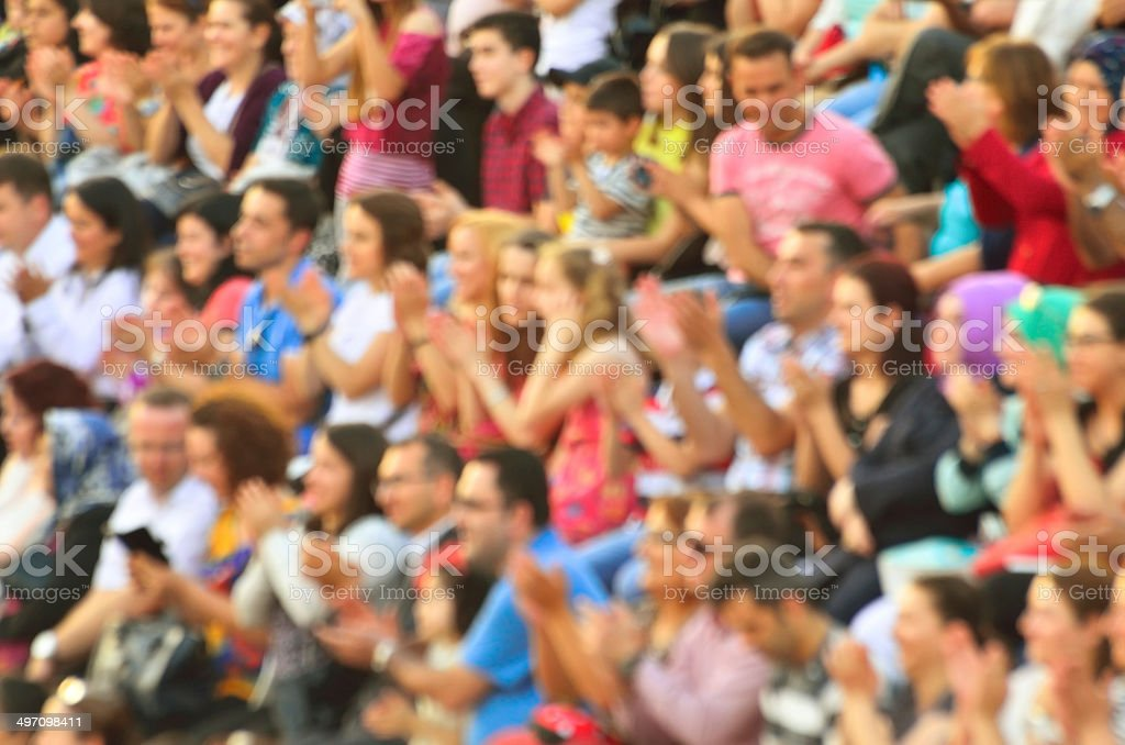Blurred crowd of spectators in a stadium stock photo