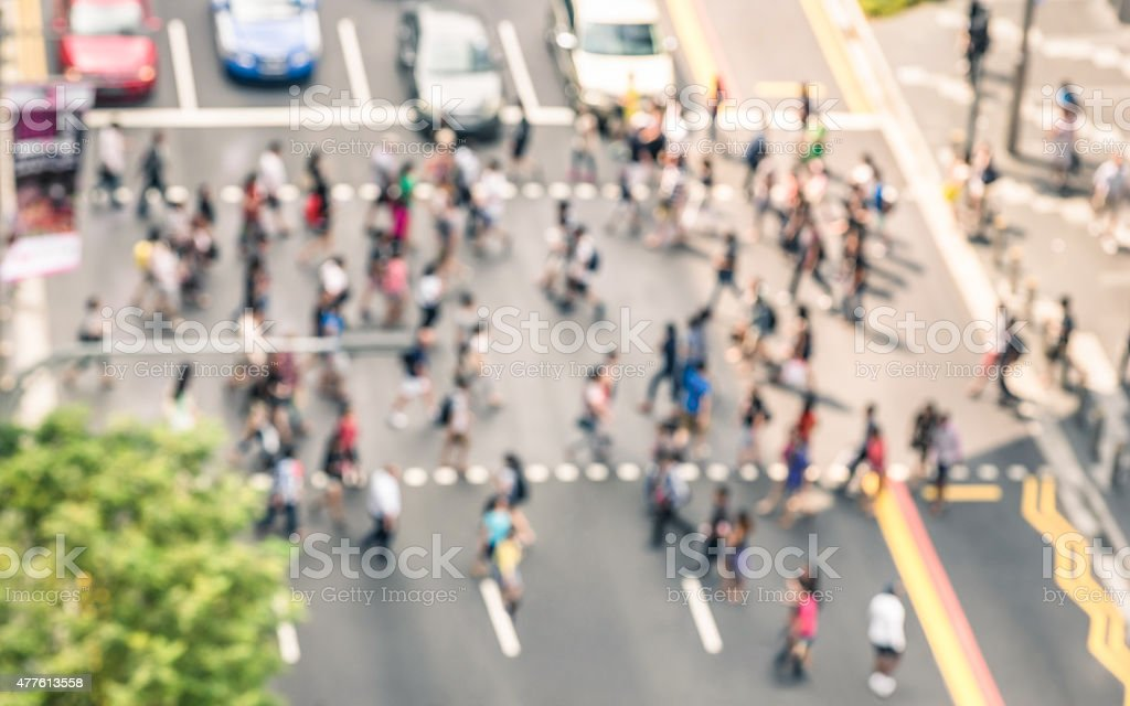 Blurred defocused abstract background of people walking on the street stock photo