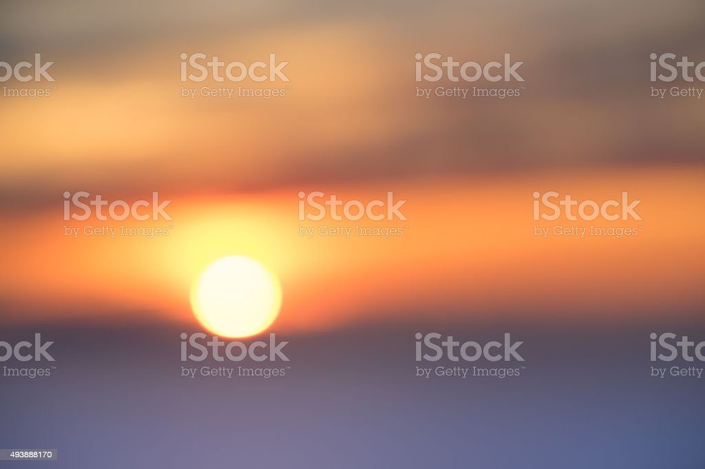 Blurred defocused background of sunset at the sea stock photo