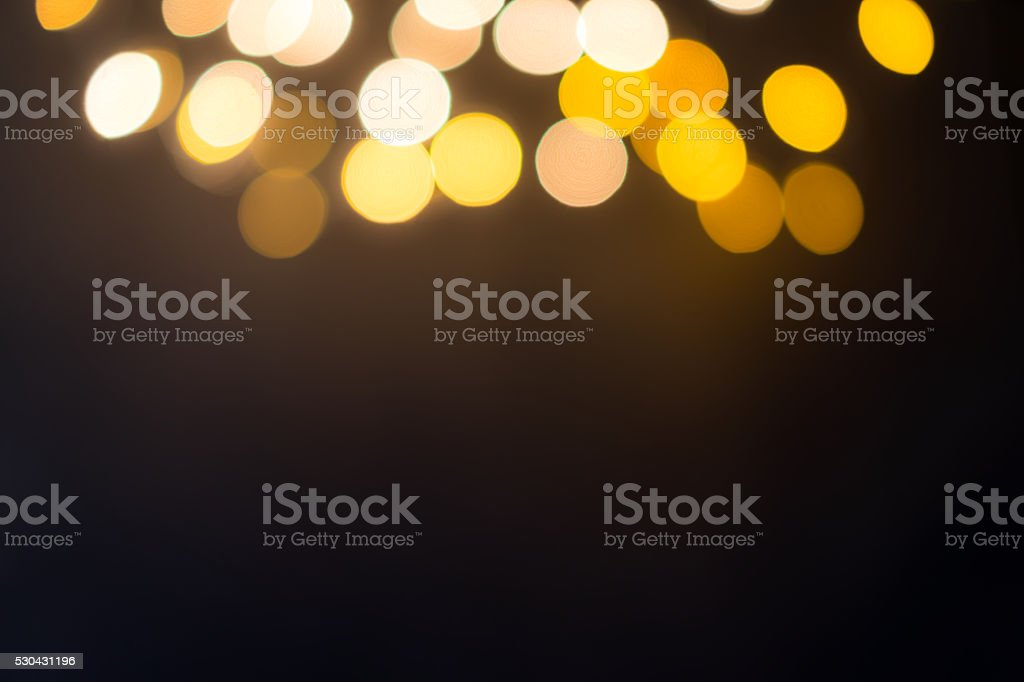 Blurred defocused Lights on black Background above stock photo
