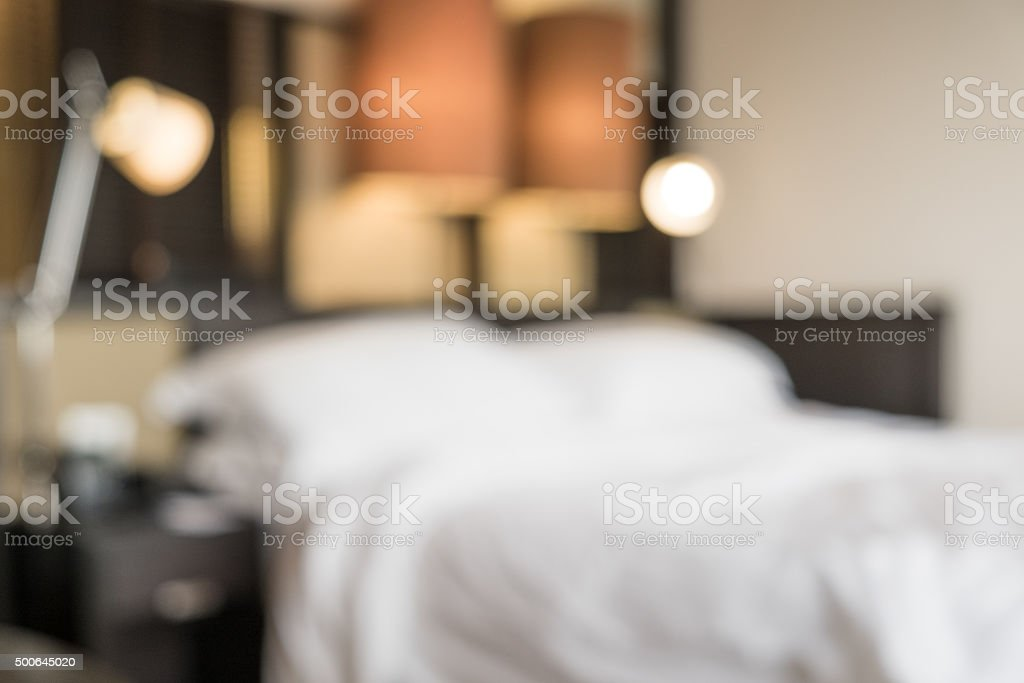 Blurred Defocussed Abstract Background of a Bedroom in a hotel stock photo