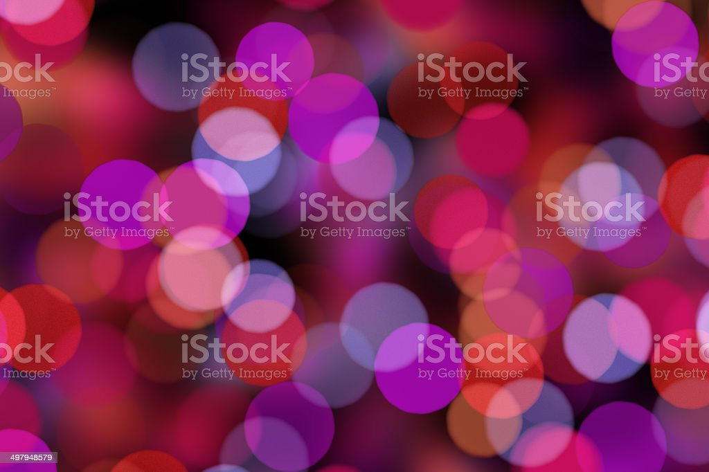 blurred dots on black background stock photo