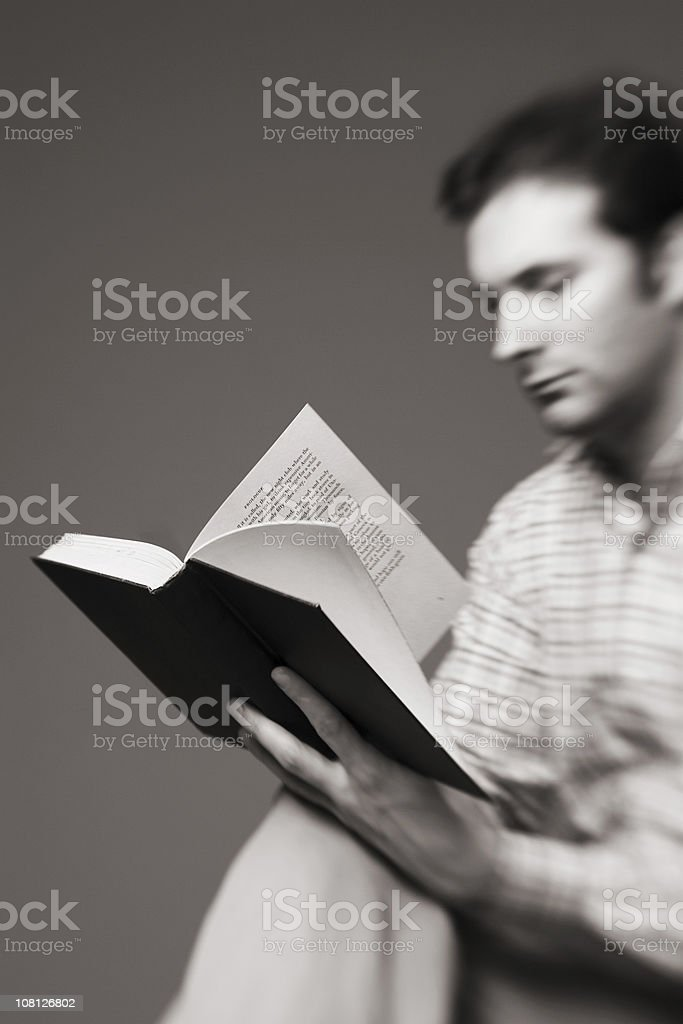 Blurred Effect of Man Reading Book, Black and White royalty-free stock photo