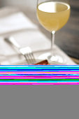Blurred fork and wine glass in half of unloaded photo