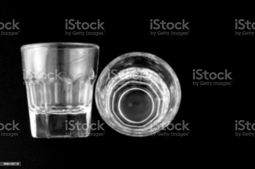 Blurred glasses on black stock photo