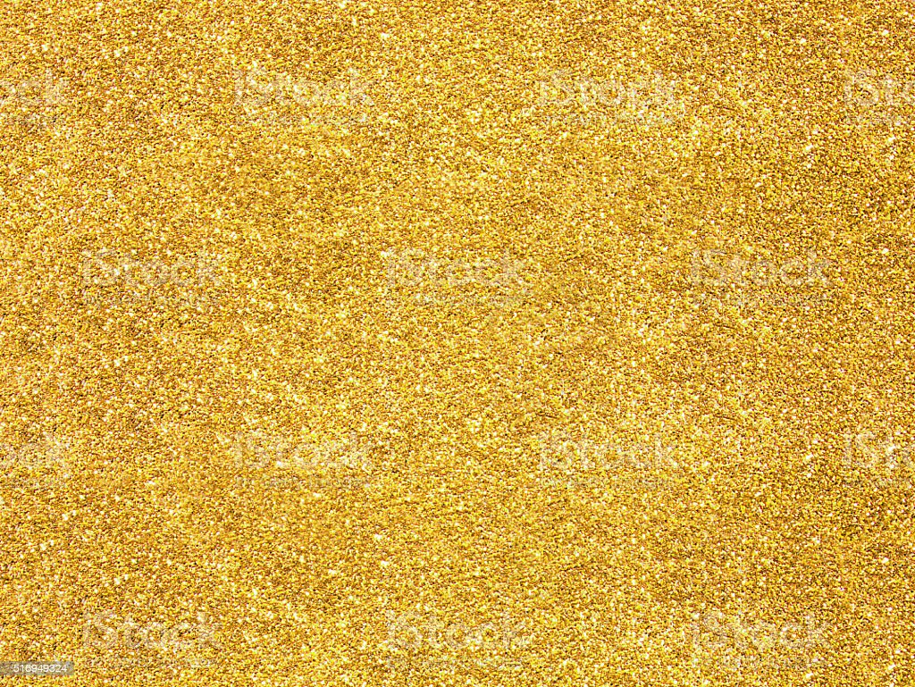 Blurred gold glitter stock photo