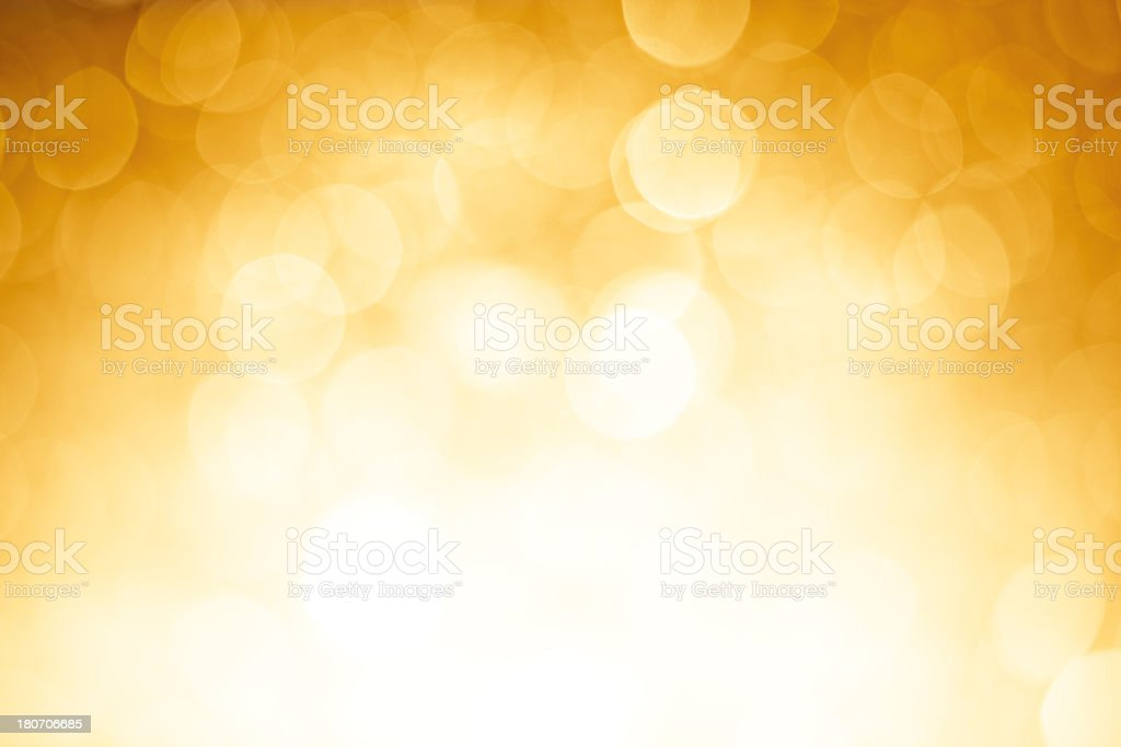 Blurred gold sparkles stock photo