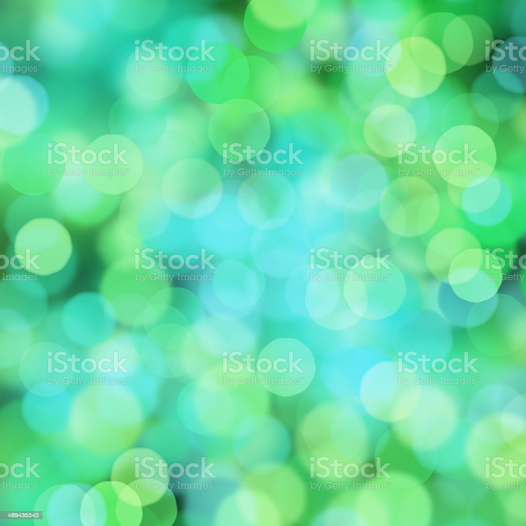 Blurred green and blue bokeh dots on black background vector art illustration