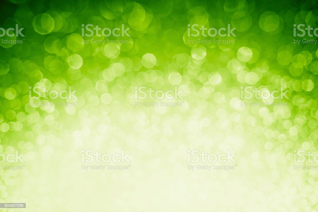 Blurred green sparkles and glitters stock photo