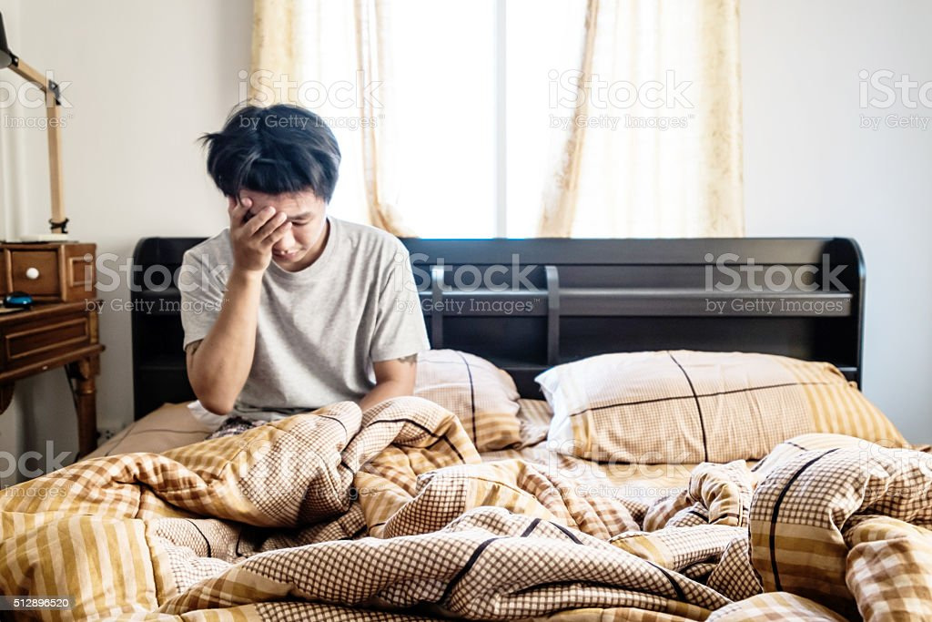 Blurred guy just waking up in the morning, selective focus stock photo
