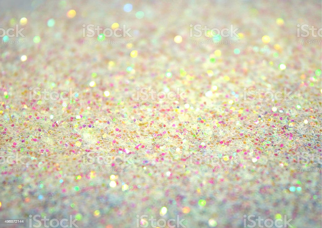 Blurred holiday background with white glitter sparkles stock photo