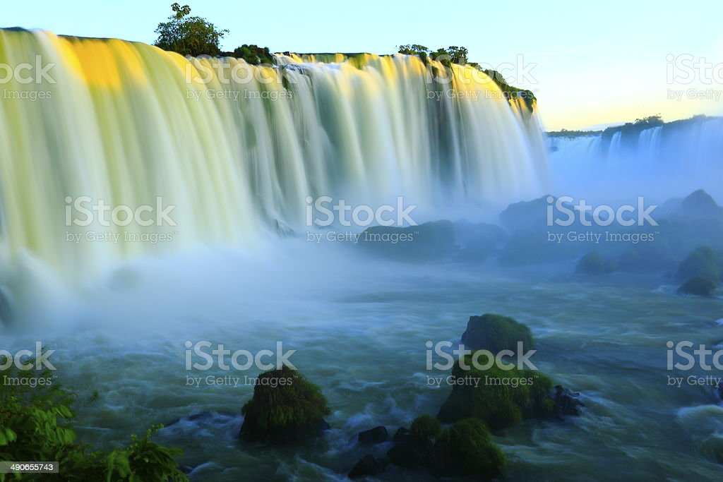 Blurred Iguacu waterfalls at sunset - Brazil / Argentina, South America stock photo