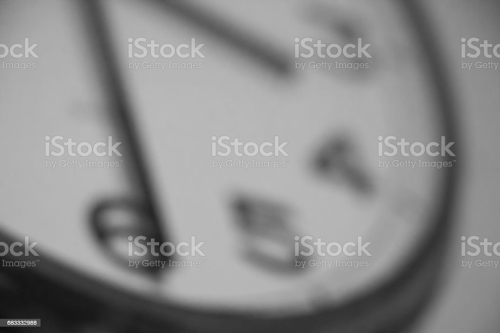 Blurred image of analog wall clock background stock photo