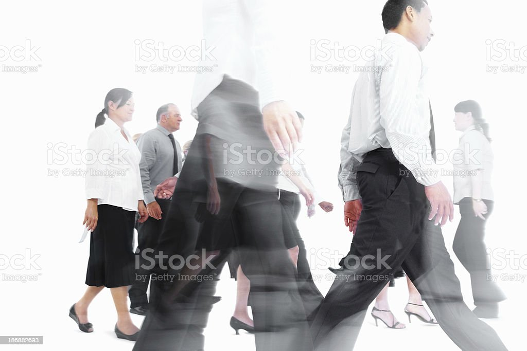 Blurred image of business people walking against white royalty-free stock photo