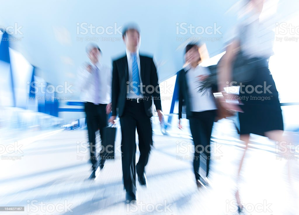 Blurred image of business people walking stock photo