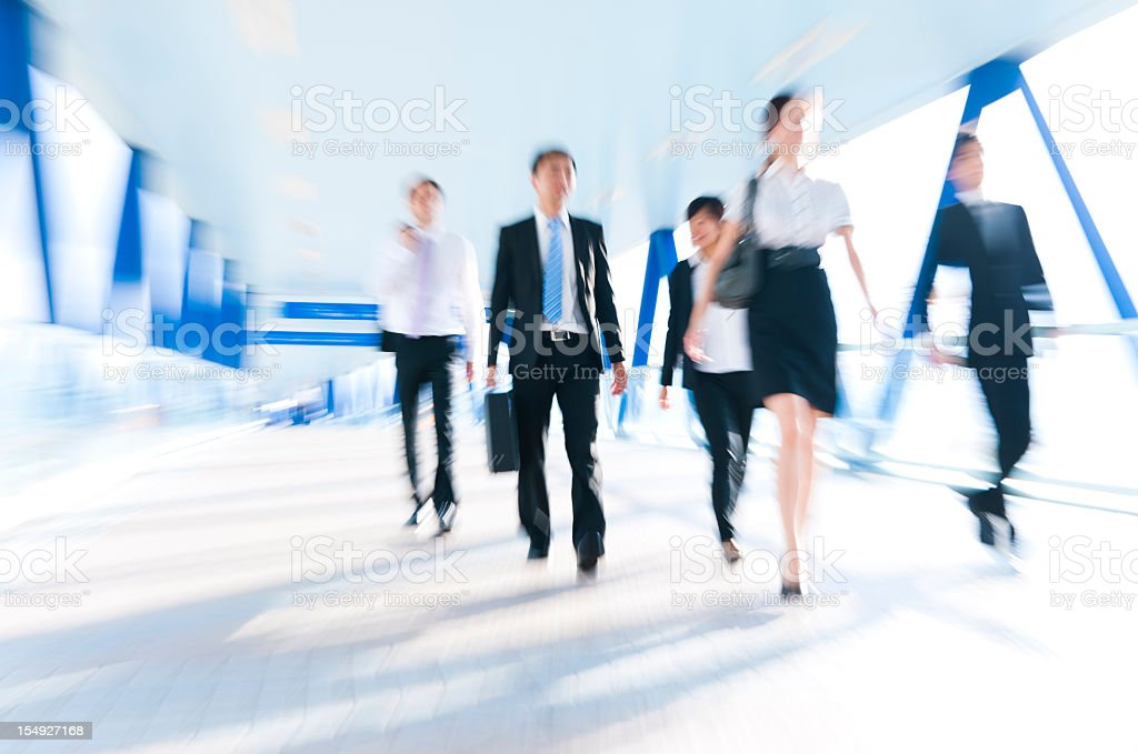 Blurred image of executives in a hallway stock photo