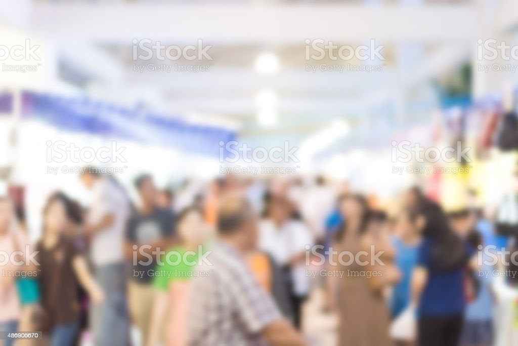 blurred image of exhibition show market product and crowd people stock photo