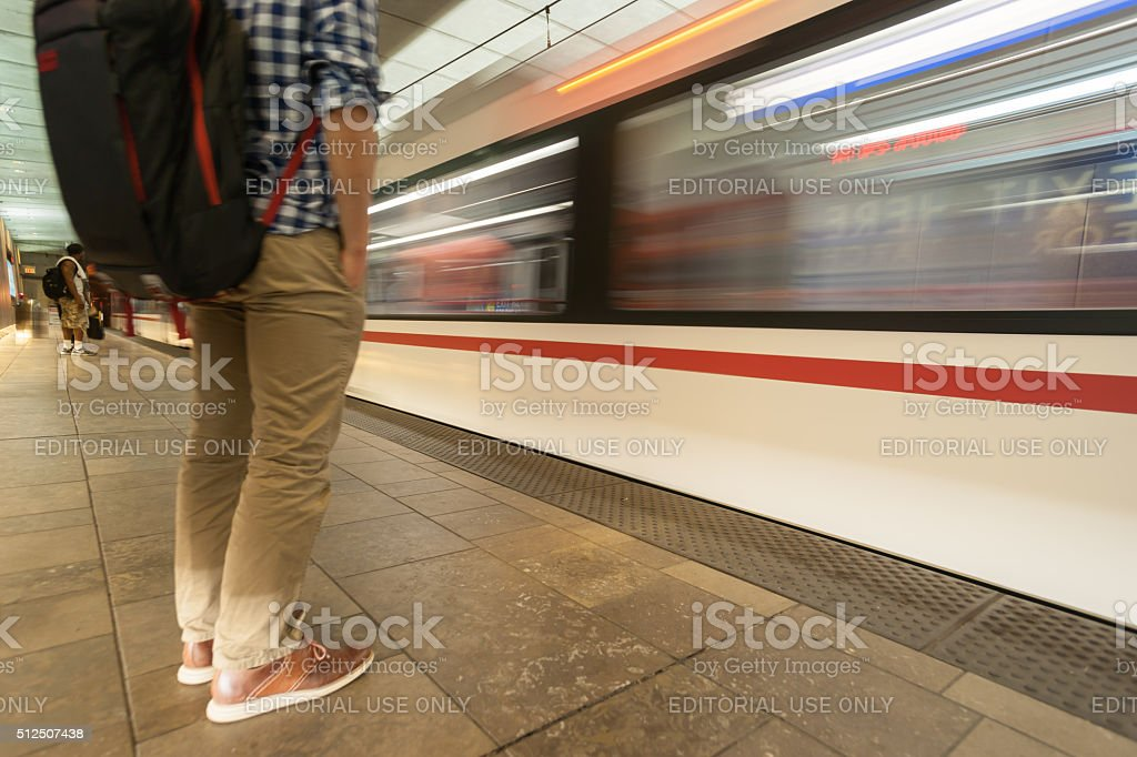 Blurred image of man as train arrives at platform. stock photo