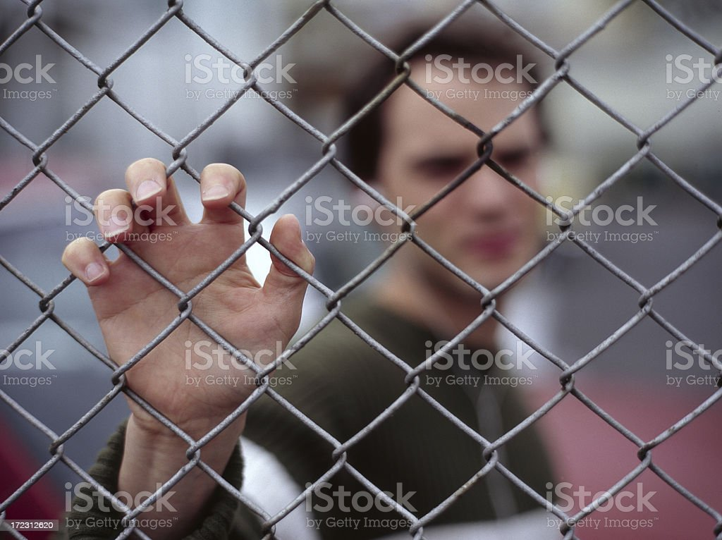 Blurred image of man holding the fence stock photo