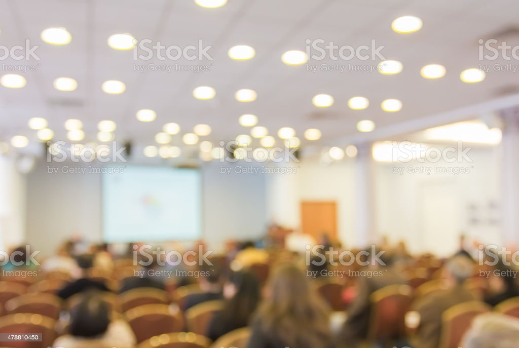 Blurred image of people in auditorium , blur background stock photo