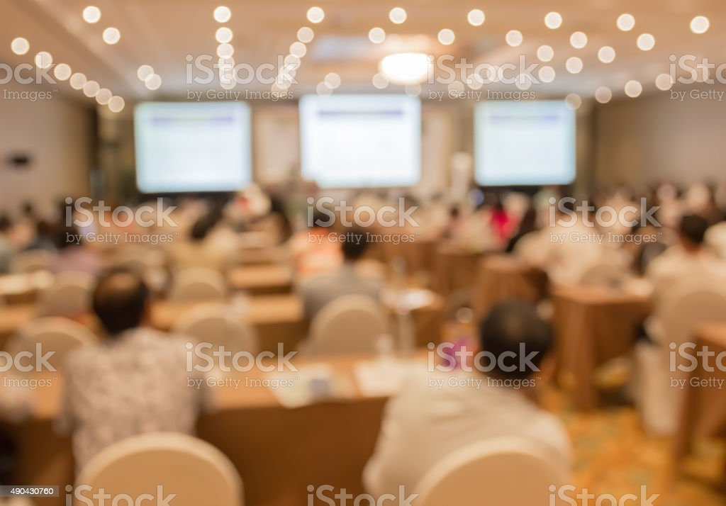 Blurred image of people in auditorium , blur with bokeh stock photo