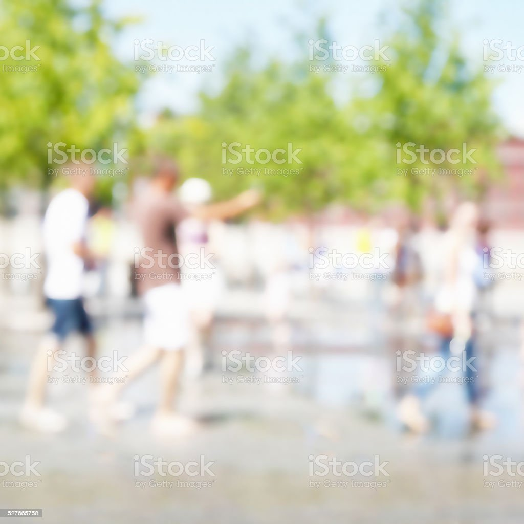 Blurred image of people in the city. stock photo