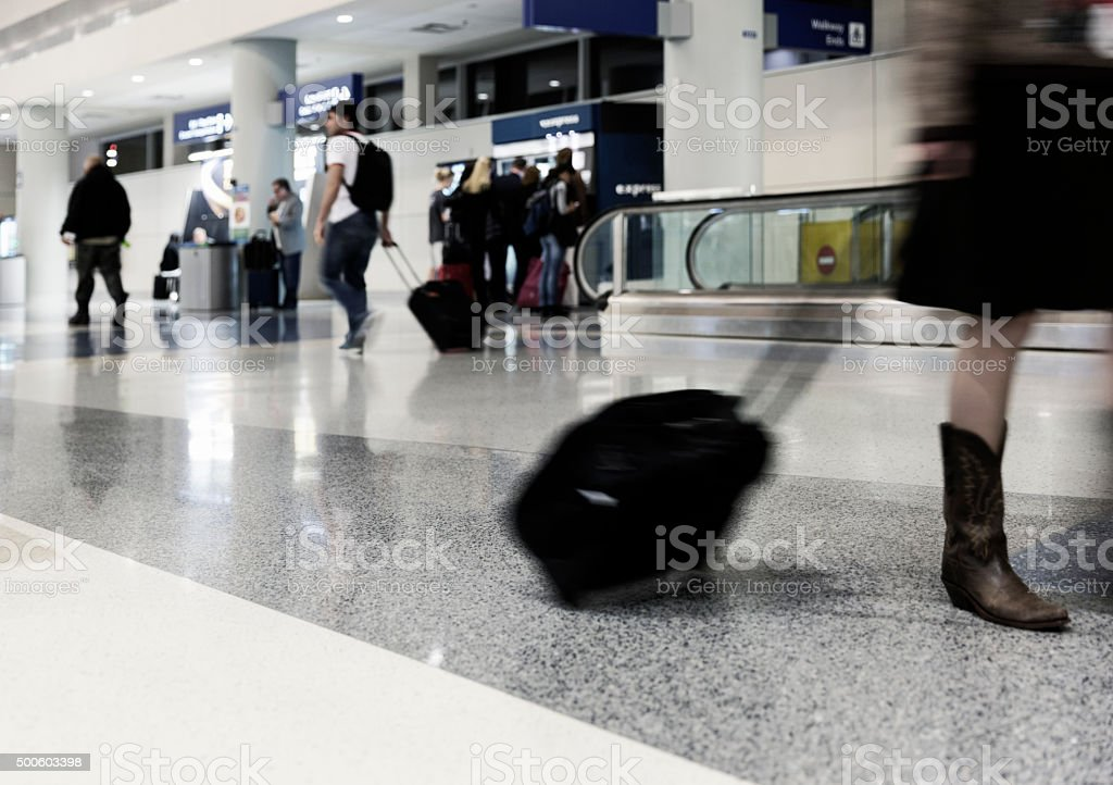 Blurred Image of People Traveling Through Airport stock photo
