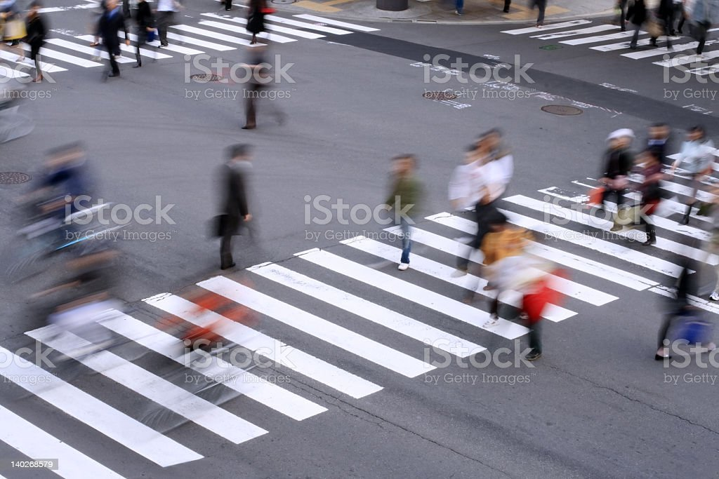 Blurred image of people walking on a crosswalk stock photo