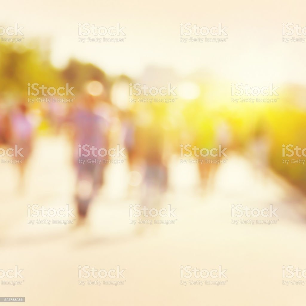 Blurred image of people walking on the street. stock photo