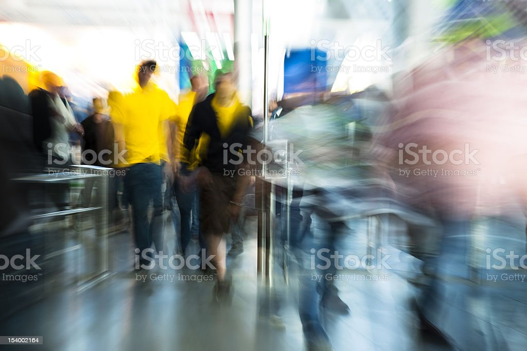 Blurred Image of People Walking Through Entrance Gate royalty-free stock photo