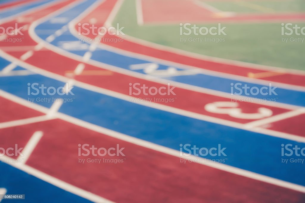 Blurred image of running track stock photo