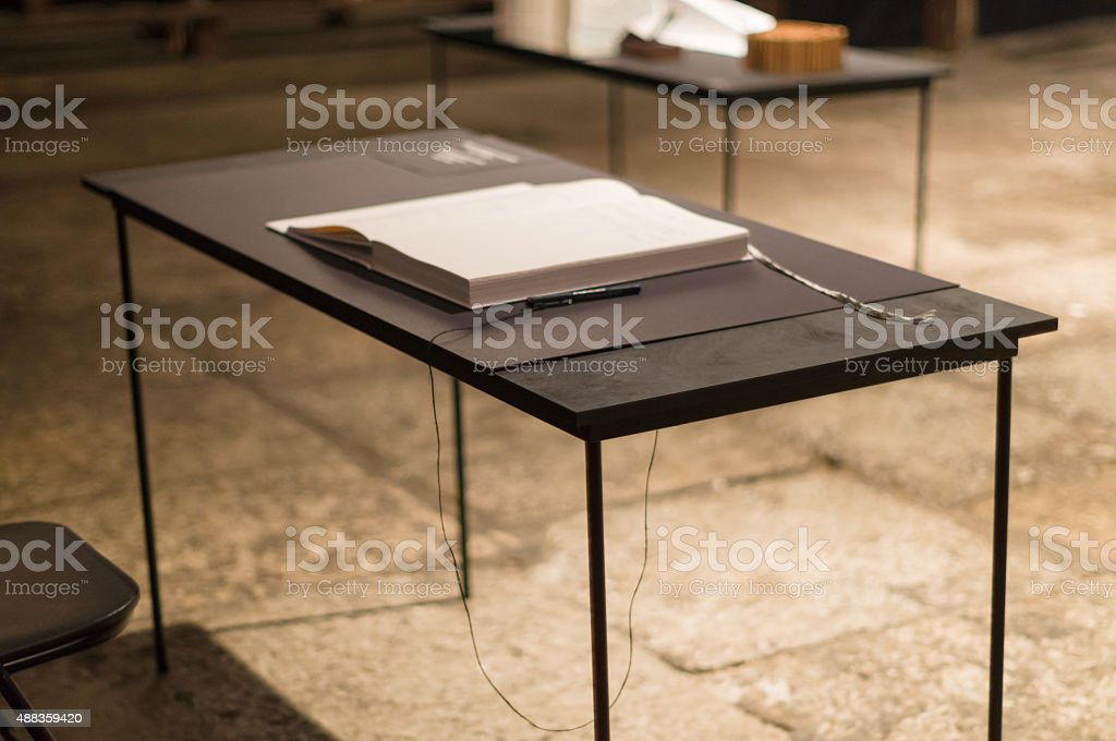 Blurred image of table with guestbook and pen stock photo