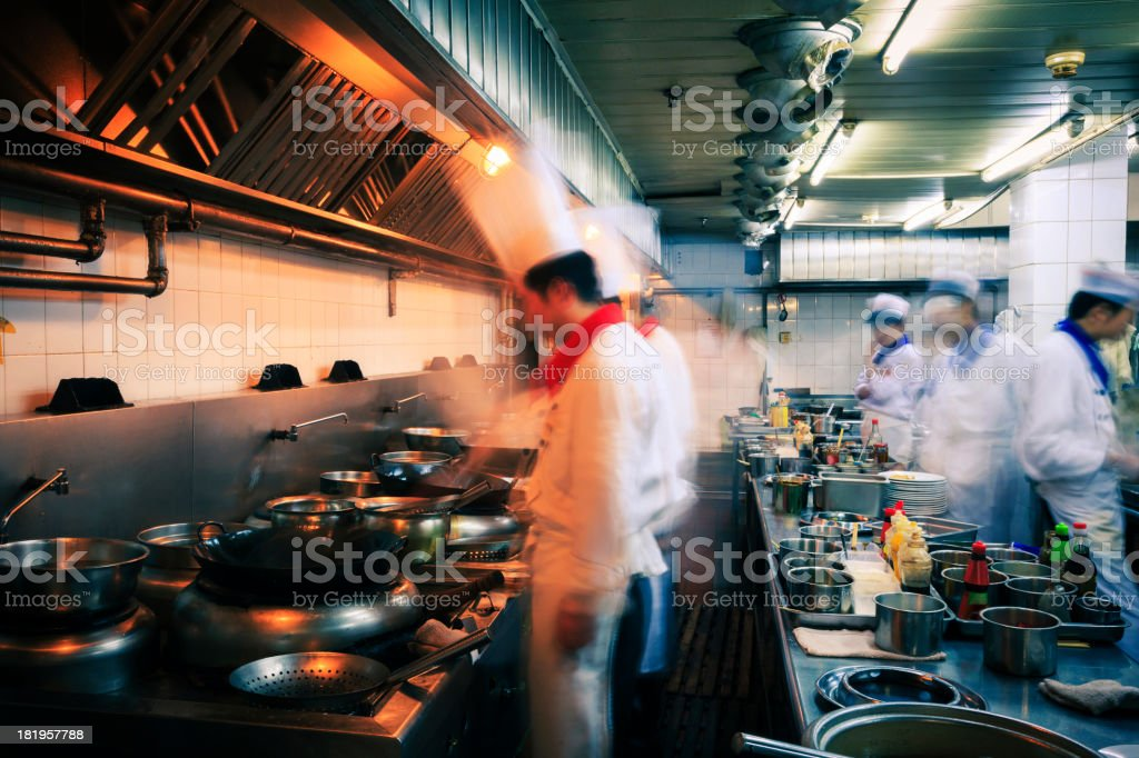 Blurred image of the fast pace of a restaurant kitchen stock photo