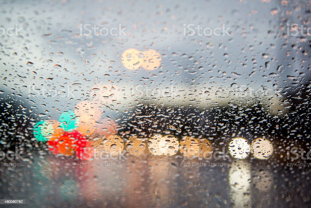 blurred image of traffic view through a car windscreen stock photo
