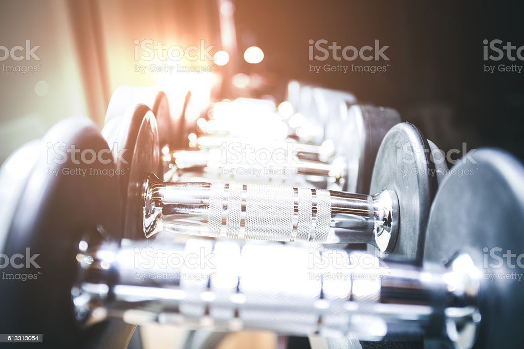 blurred  Image Rows of dumbbells in the gym stock photo