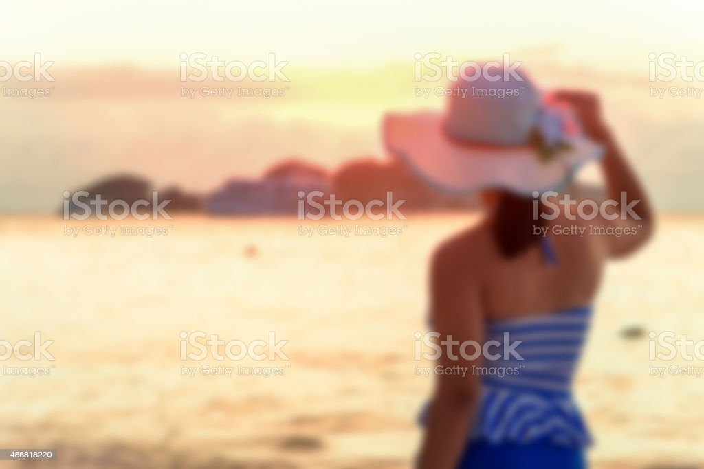 Blurred image tourist woman on the beach stock photo