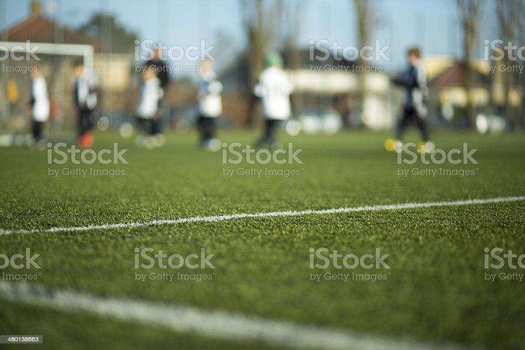 Blurred kids playing soccer stock photo