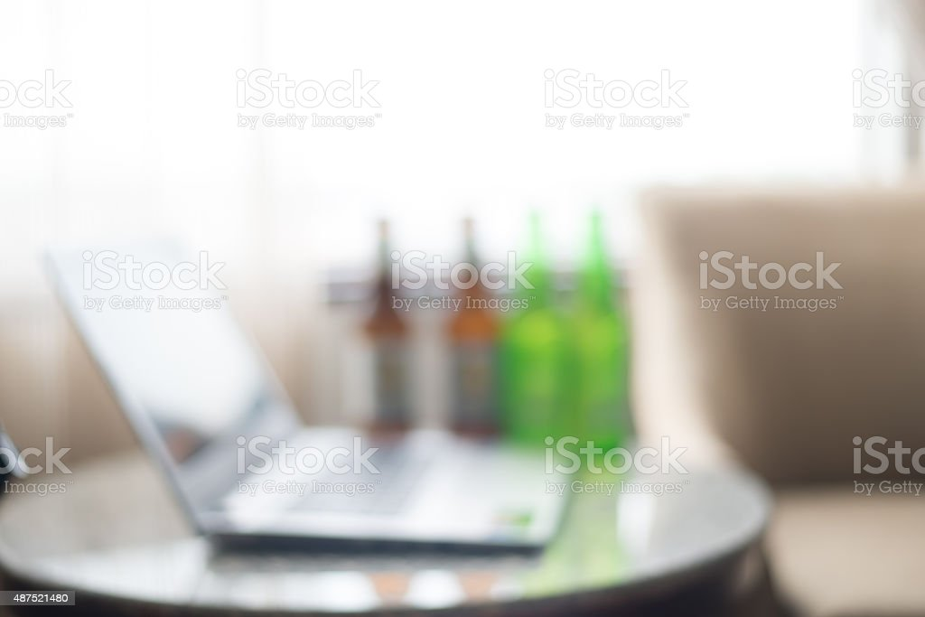 Blurred Laptop computer and beer. stock photo