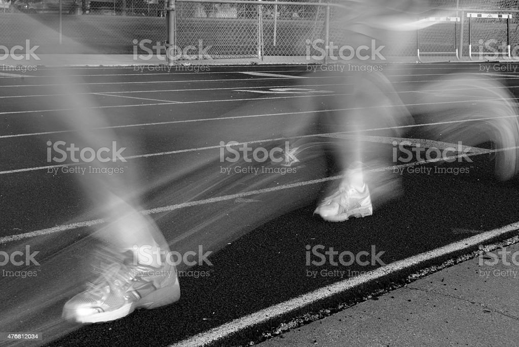Blurred legs running on track stock photo