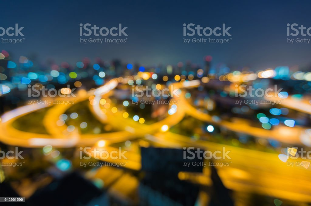 Blurred light highway interchanged with city downtown stock photo